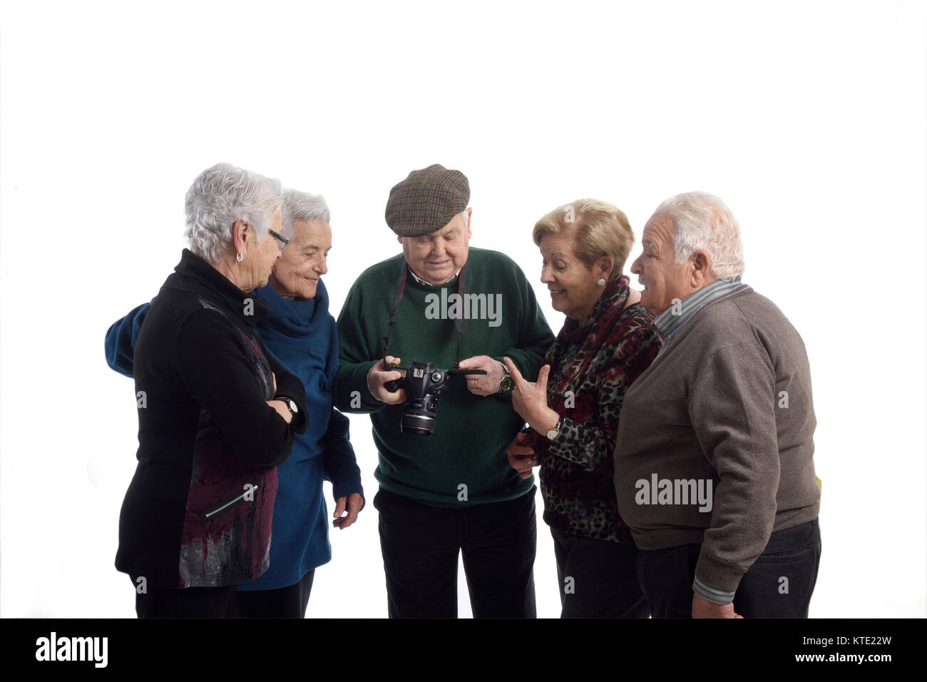 group of elders at the screen reflex camera - Stock Image