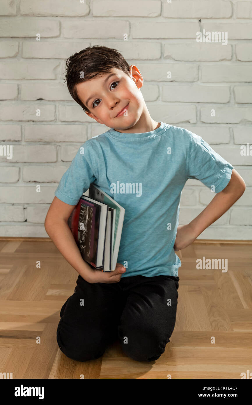 cute boy with books school education - Stock Image