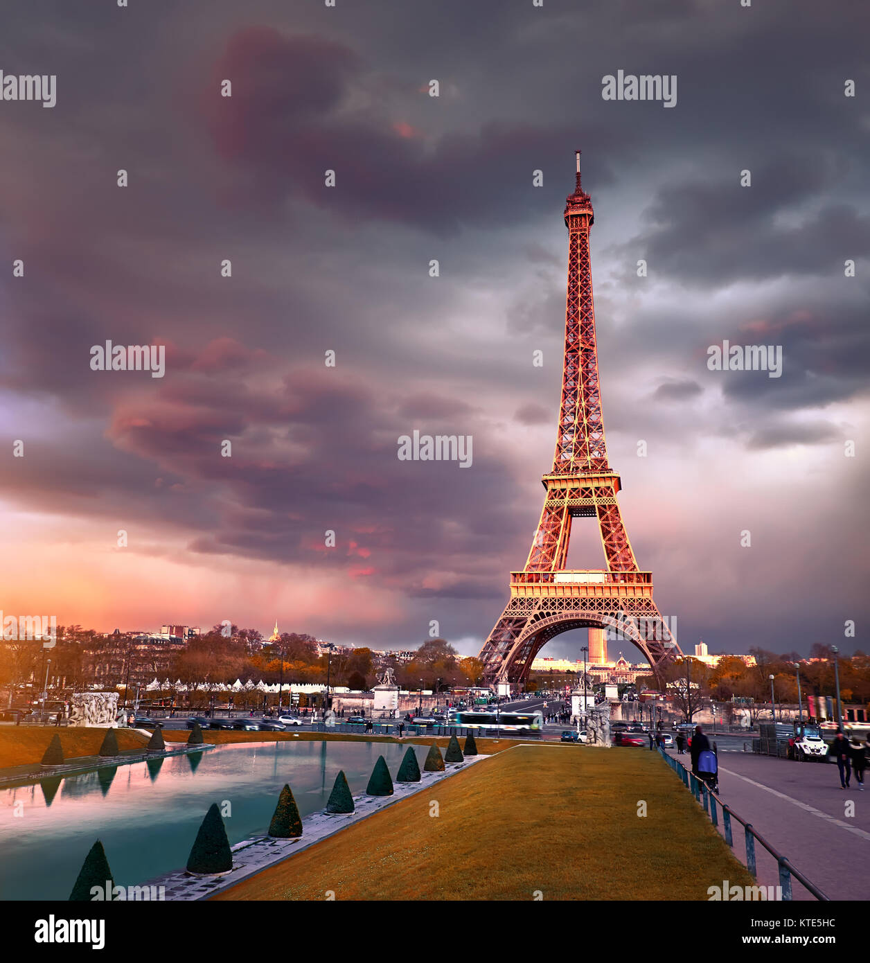 Eiffel tower on a sunset half-lit with last rays of the setting Sun. Panoramic toned image. Stock Photo