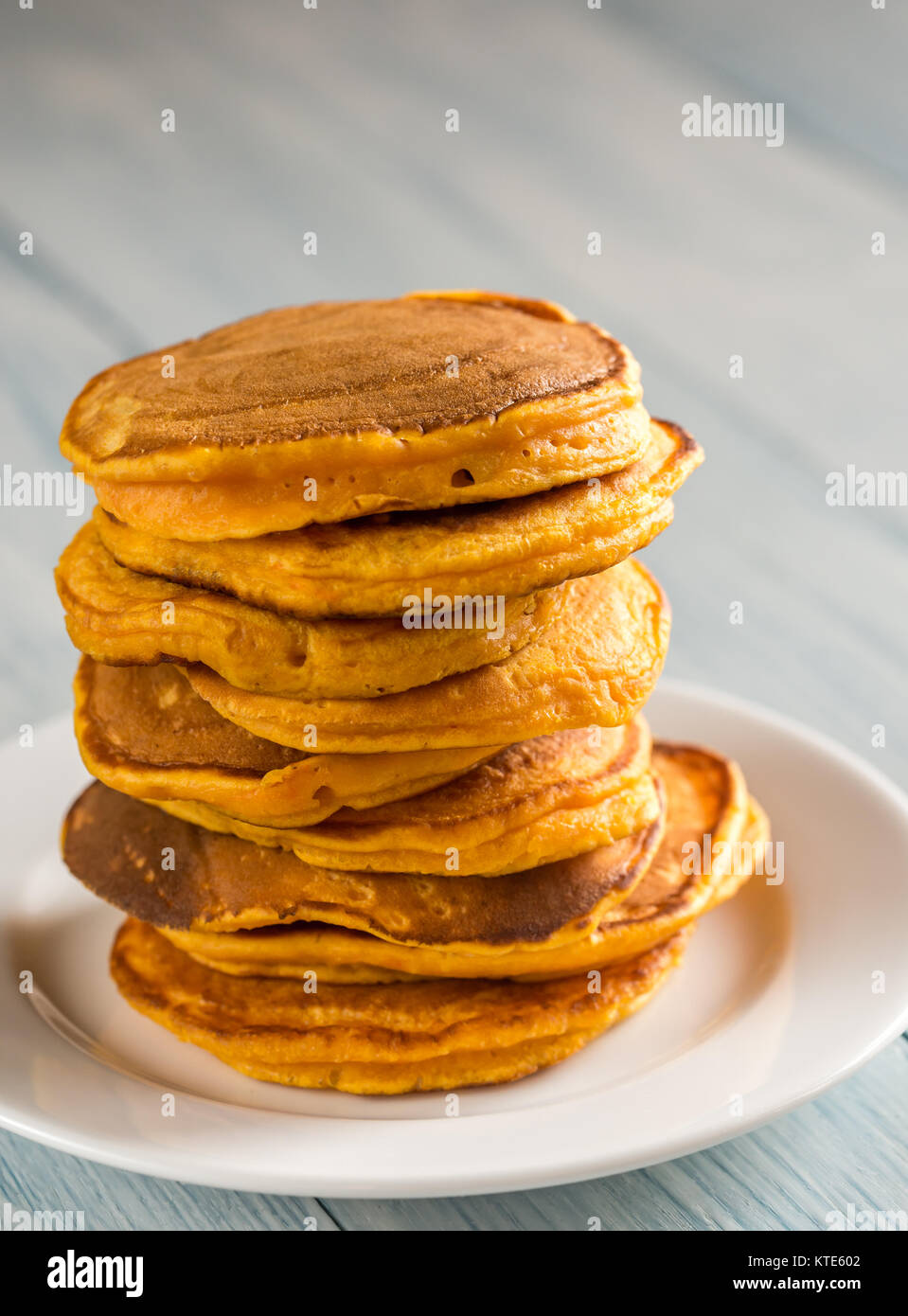 Stack of pumpkin pancakes on the plate Stock Photo