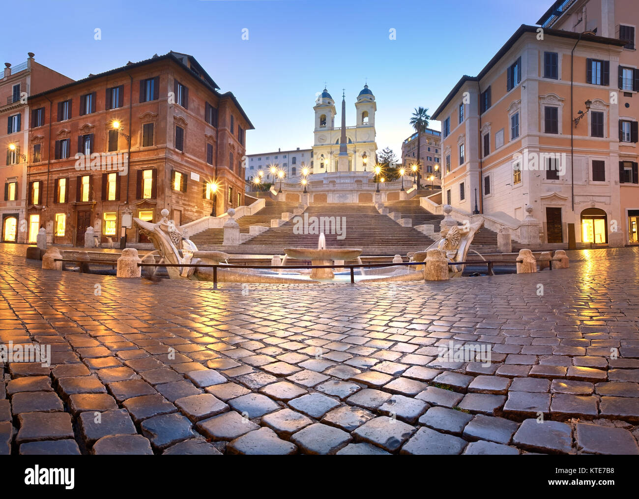 Spanish Steps and a boat-shaped fountain on Piazza di Spagna in Rome, Italy. Early morning panoramic shot after - Stock Image