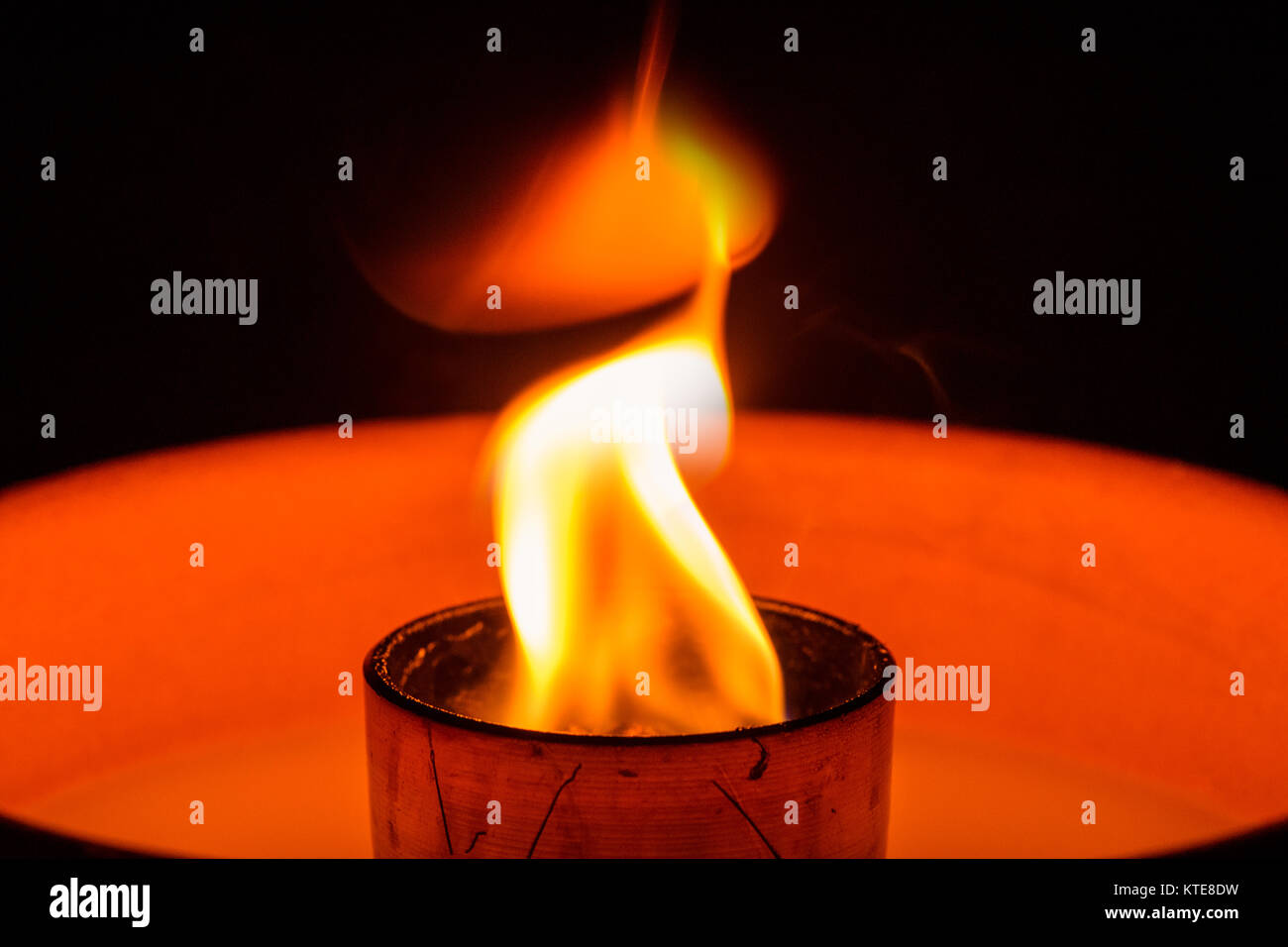 Flame of Waxburner in the darkness. Stock Photo