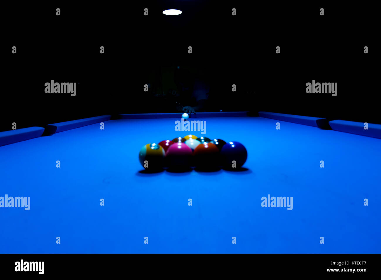 Aiming for an initial kick at the billiard pool table - Stock Image