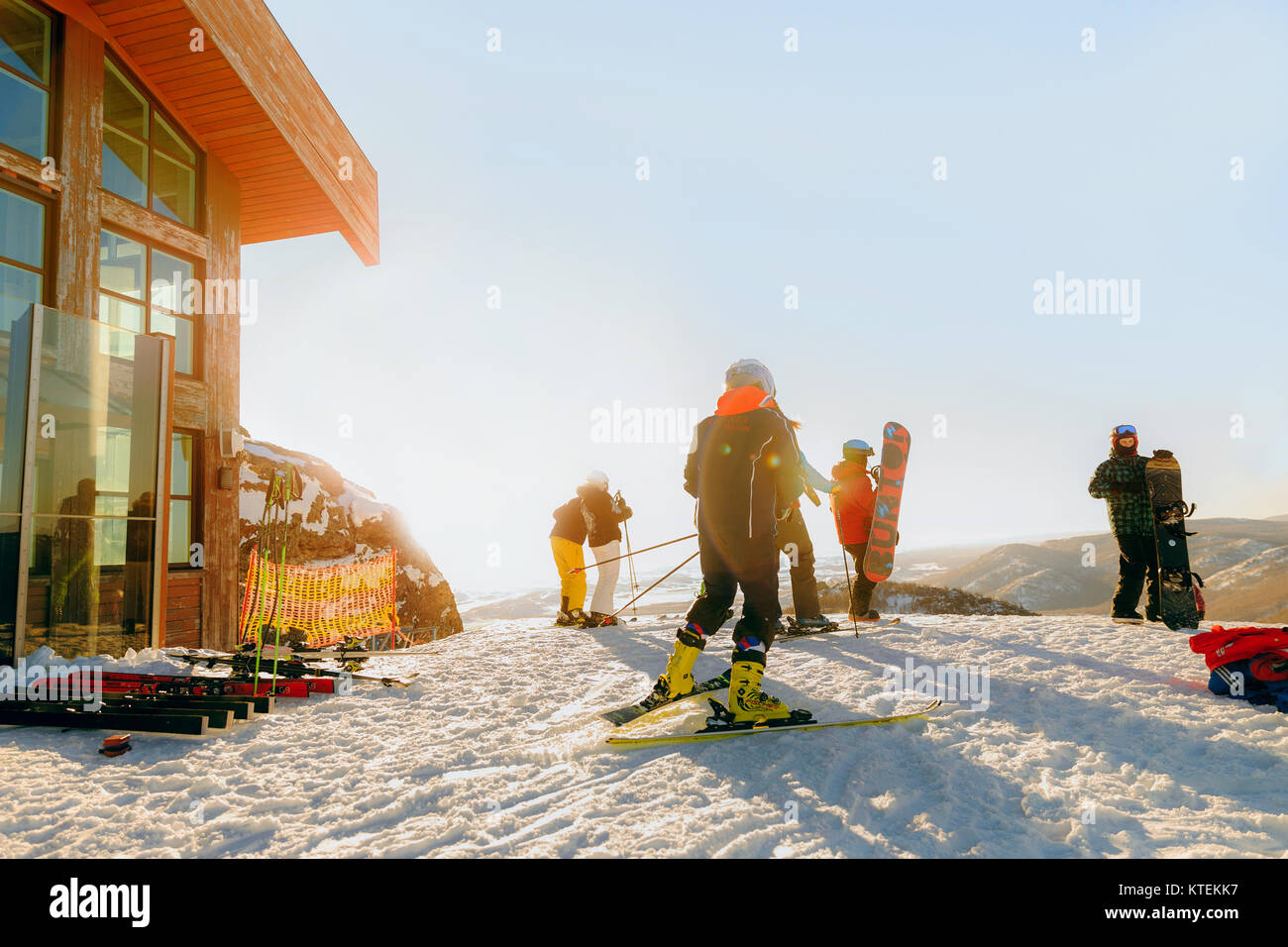 Magnitogorsk, Russia - December 18, 2017: group of snowboarders and skiers prepare to descend on mountain - Stock Image