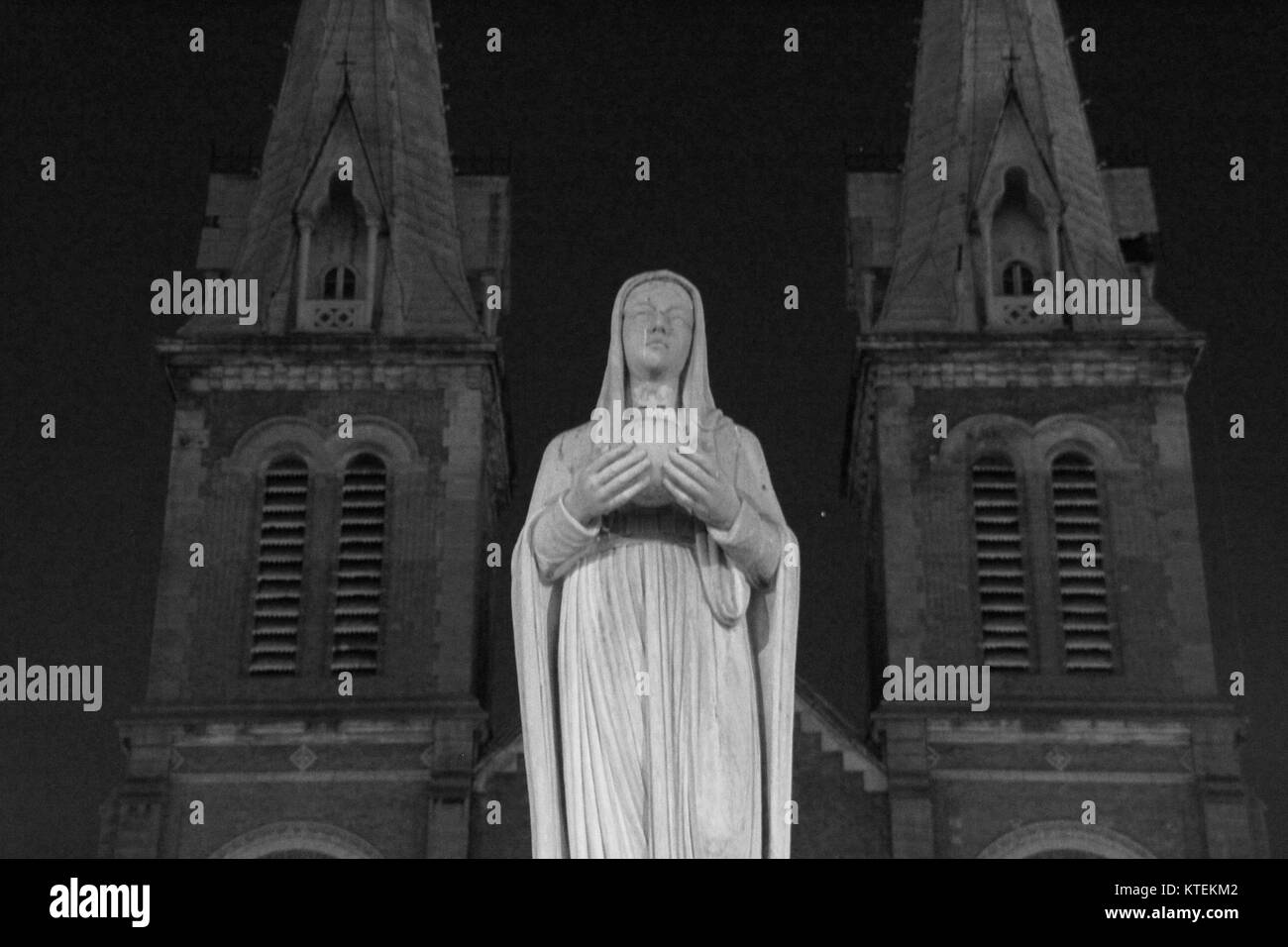 Maria Statue before The HCMC/Ho Chi Minh City Cathedral at Night 1 - Stock Image