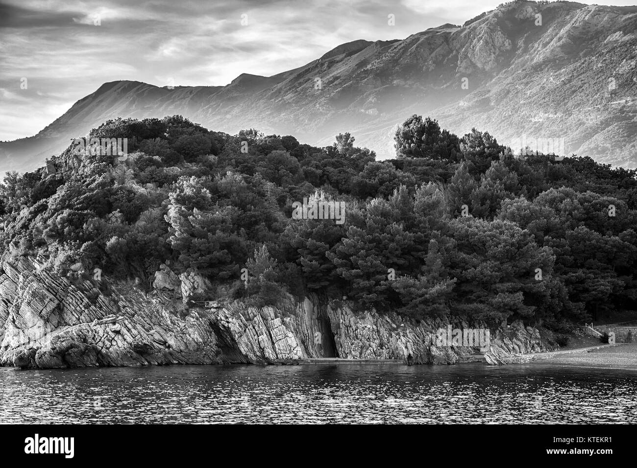 Montenegro mountainand sea landscape. Vacations summer background. Vintage black and white toned - Stock Image