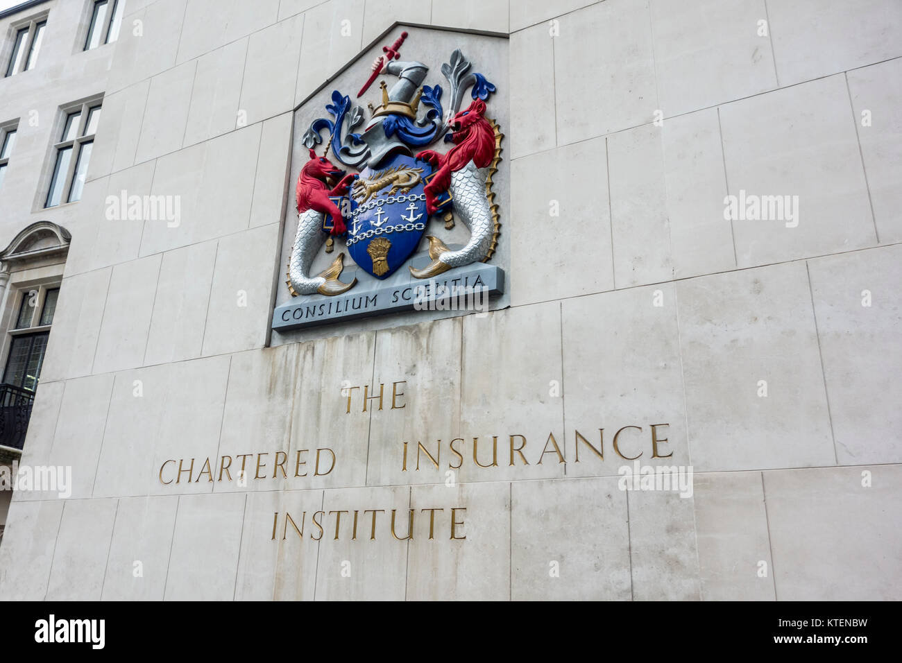 The Chartered Insurance Institute sign and shield or crest in the City of London. Consilium scientia - Stock Image