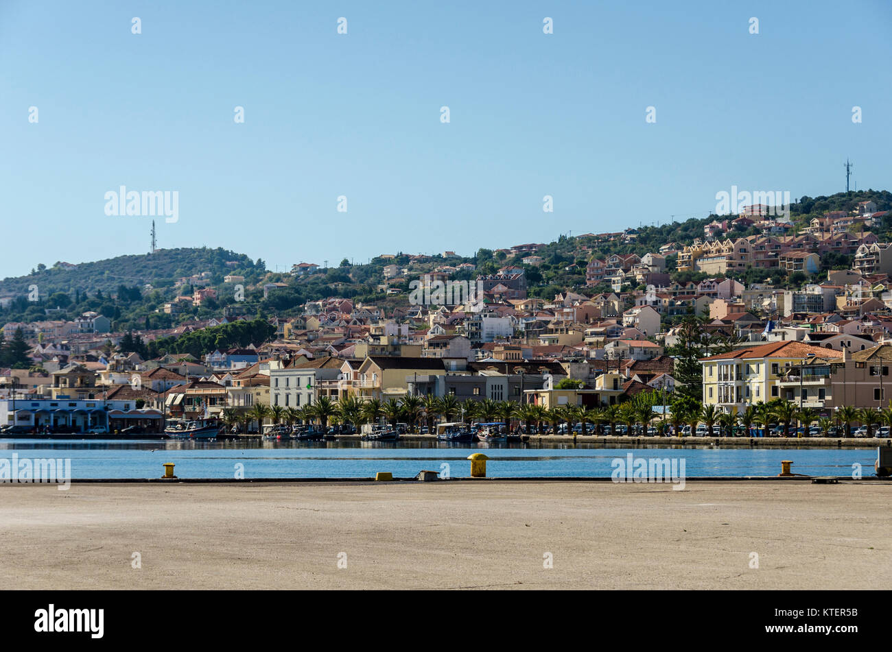 View from a dock of the port and city of Lixouri located in the same bay and facing the city of Argostoli capital - Stock Image