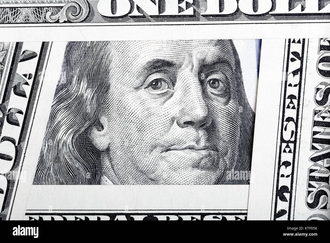 Benjamin Franklin on the one hundred dollar bill framed by other - Stock Image