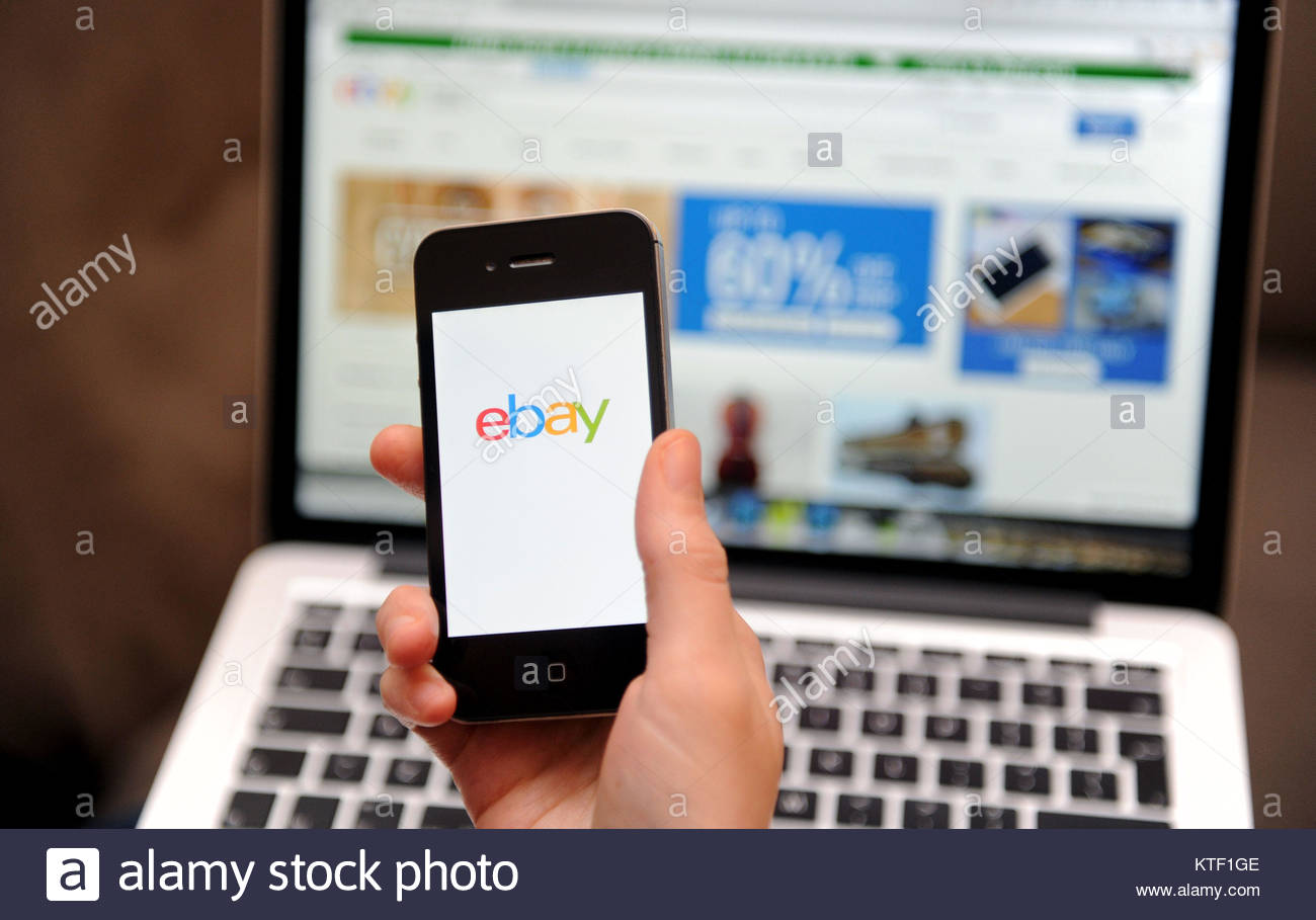 File photo dated 01/12/14 of a person using a smartphone to browse Ebay. The UK is set to flog millions of pounds - Stock Image