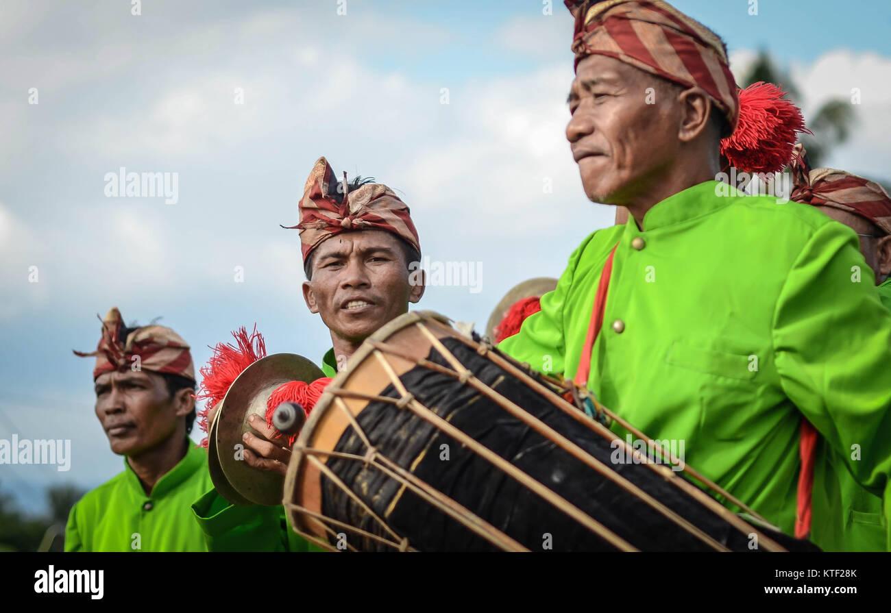 Balinese traditional music player during Utsawa Dharma Gita ceremony. - Stock Image