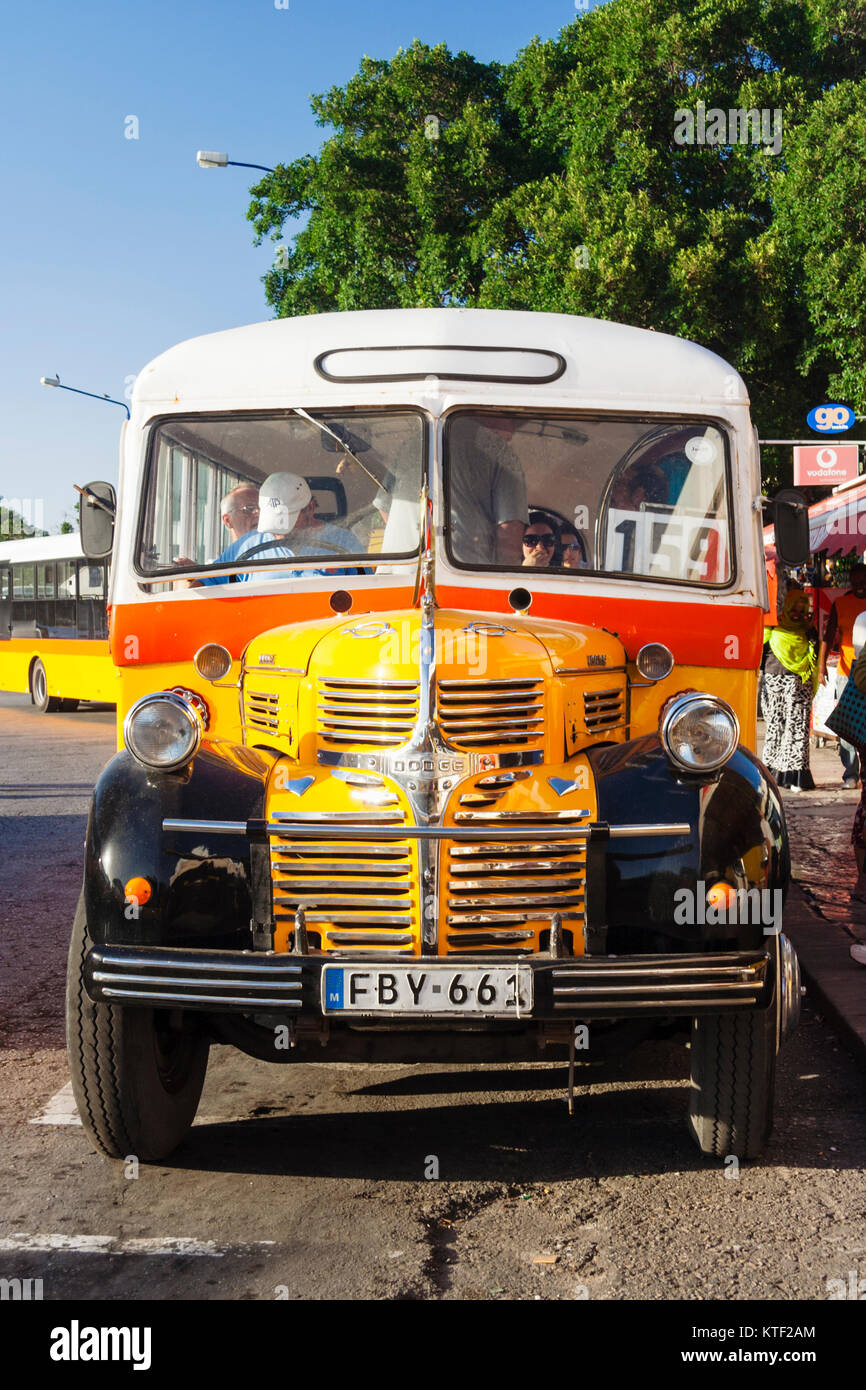 Vintage Dodge bus at Central bus terminus in Valletta, Malta - Stock Image