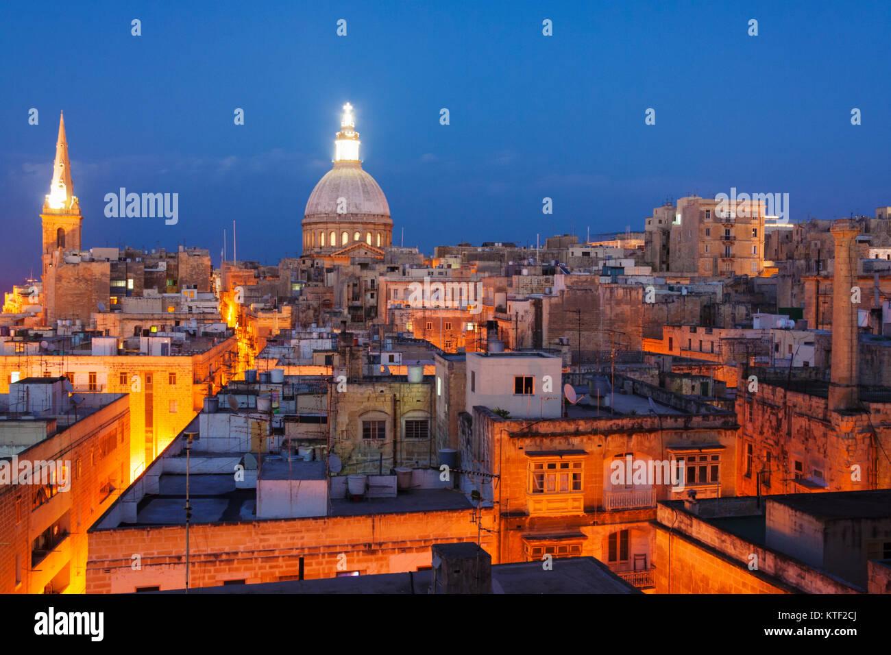 Overview at dusk of illuminated historic city of Valletta, Malta - Stock Image