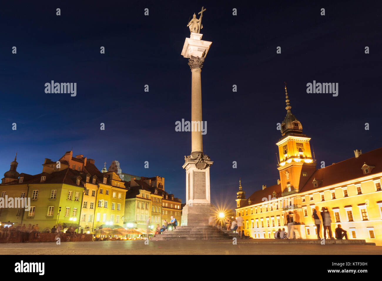 Castle square illuminated at dusk. Warsaw, Poland - Stock Image