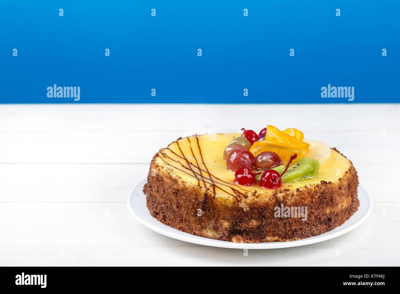 delicious birthday cake, cream cake with cherries, oranges and chocolate, space for text - Stock Image