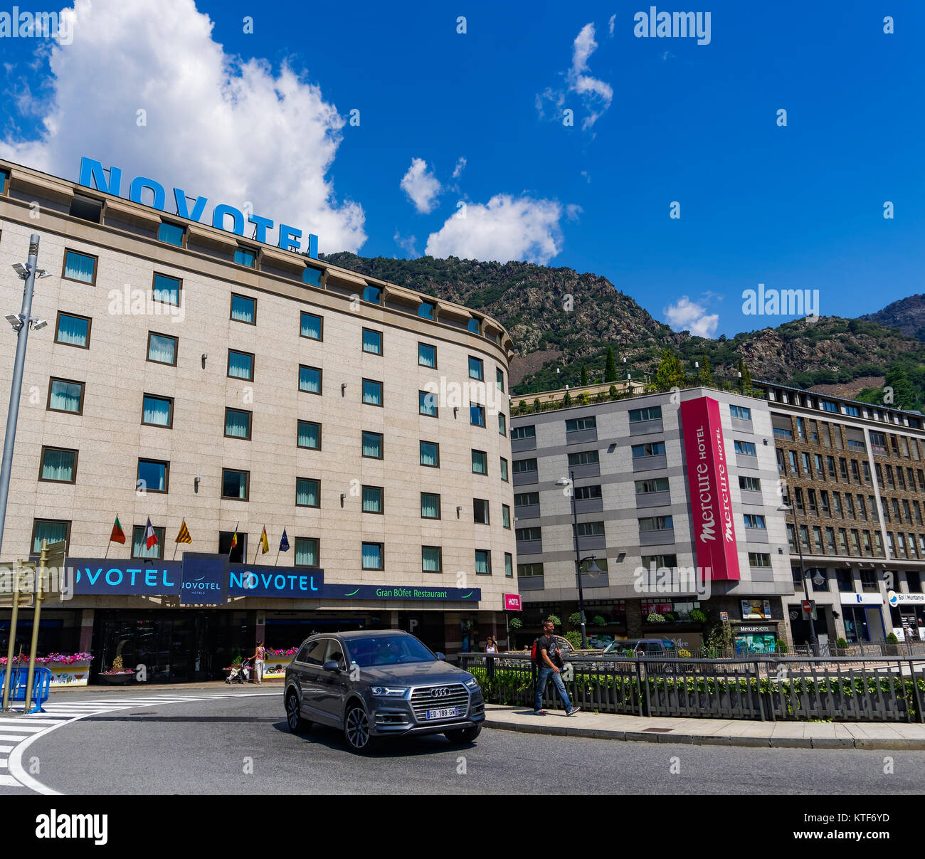 Andorra la Vella, Andorra Hotels facade. Day view of local buildings by a green hill on the capital of the Principality - Stock Image