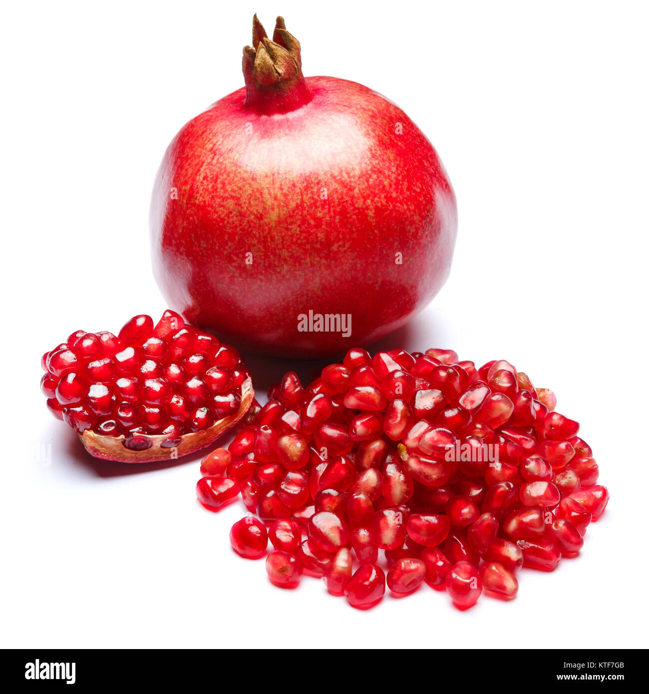 Pomegranate and seeds on white background close-up - Stock Image