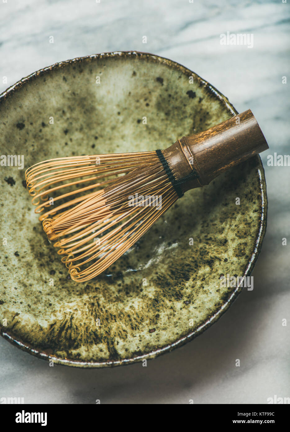 Chasen bamboo whisk, Chawan bowl over grey background, top view - Stock Image