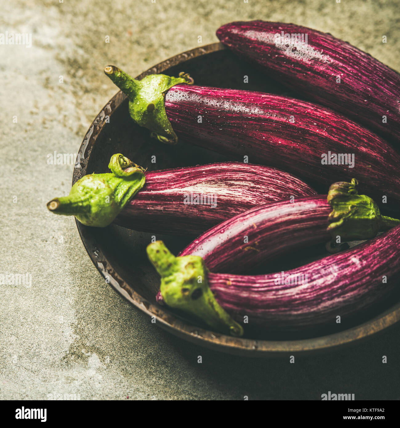 Fresh raw Fall harvest purple aubergines, square crop - Stock Image