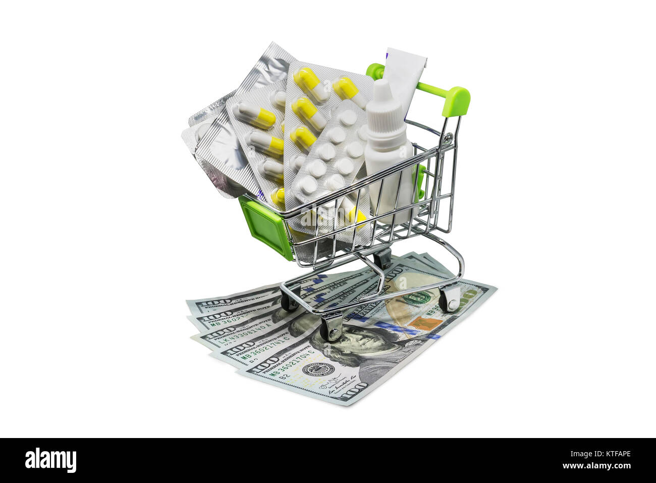 Prescription drugs on money representing rising health care costs. Isolated on white. medications in the cart. buying - Stock Image
