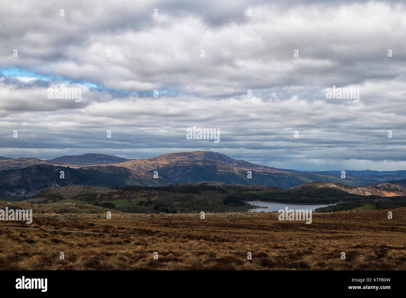 Scottish Highlands in Springtime looking over moorlands and across Loch ness and towards mountains beyond, - Stock Image