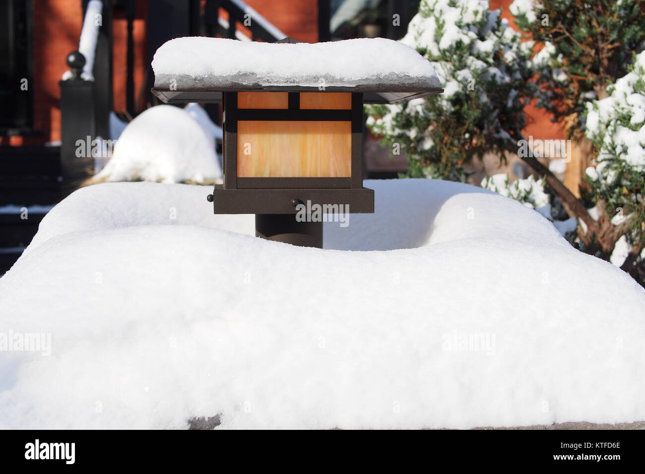 A pathway lamp buried in fresh snow in a Glebe garden, Ottawa, Ontario, Canada. - Stock Image