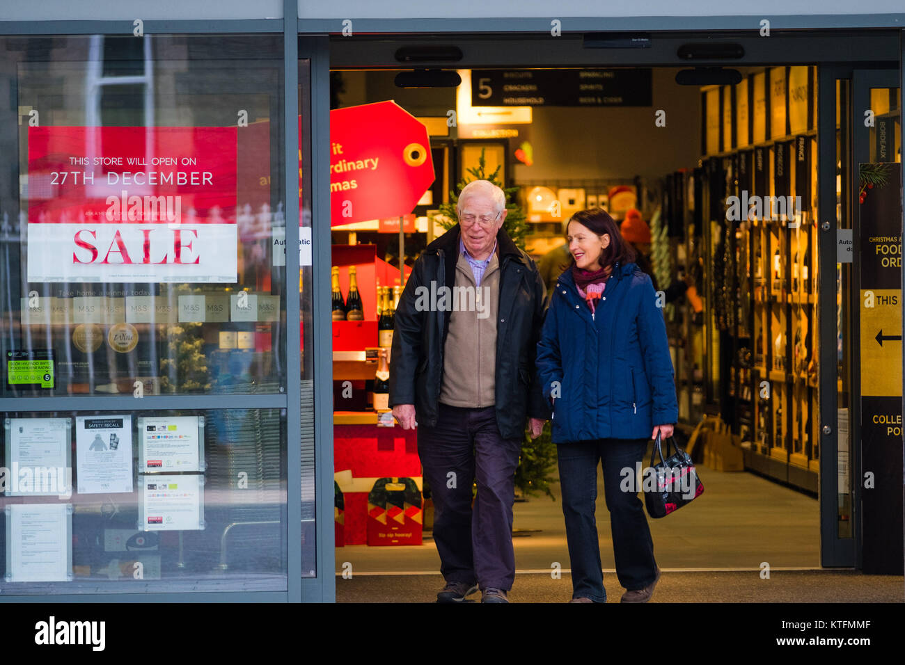 Aberystwyth Wales UK, Christmas Eve,  Sunday 24 December 2017  UK Weather: People out doing their last minute shopping - Stock Image