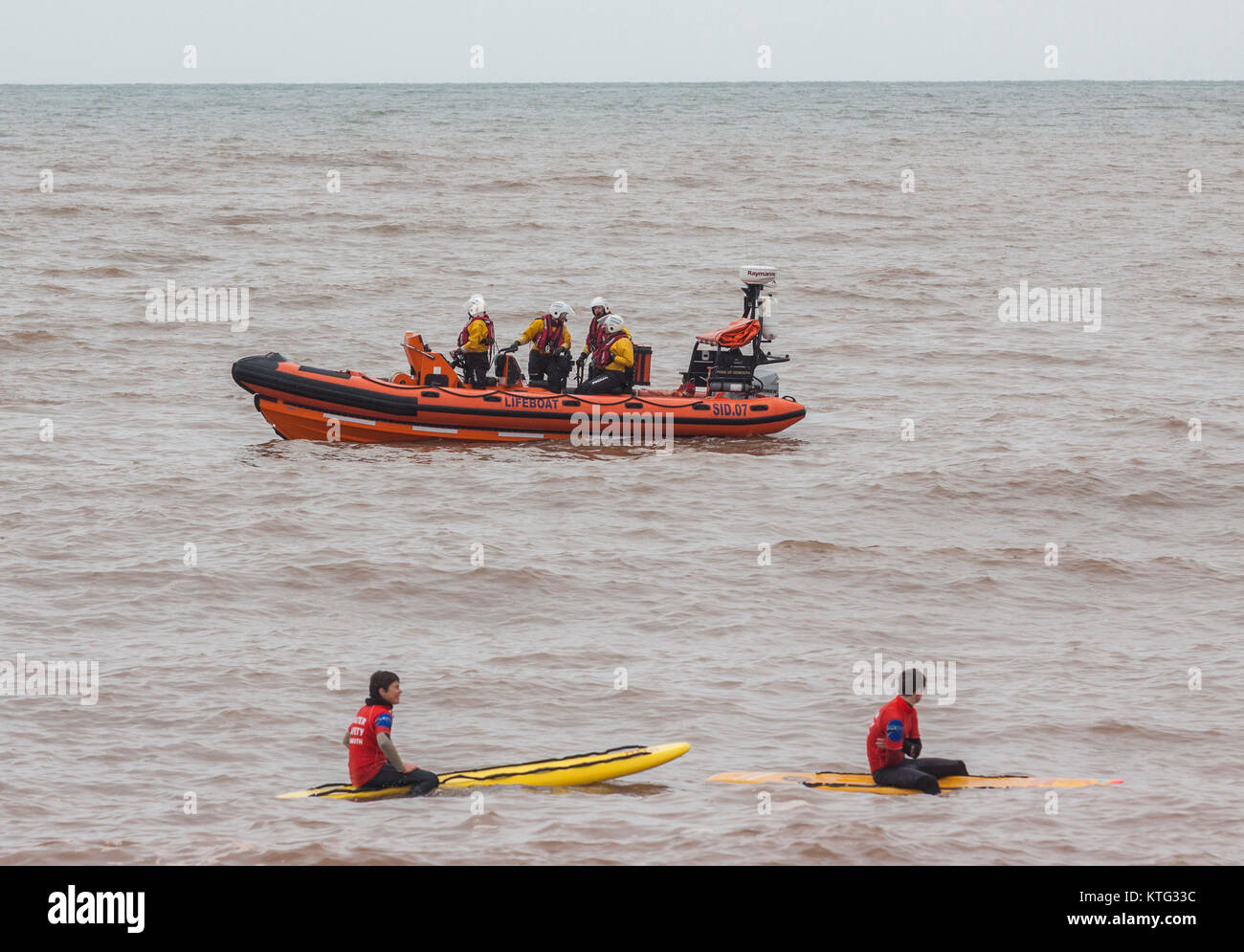 Sidmouth, Devon 26th Dec 17 Life saving teams out on the water to ensure the safety of swimmers during the annual - Stock Image