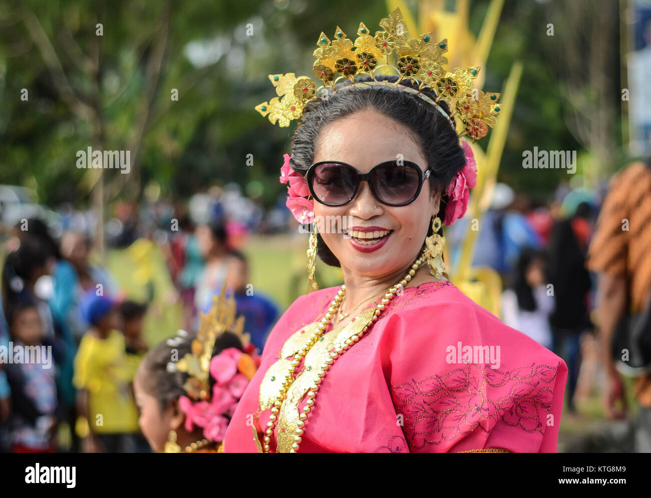 Modern Sulawesi woman dress in traditional Bugis clothes - Stock Image