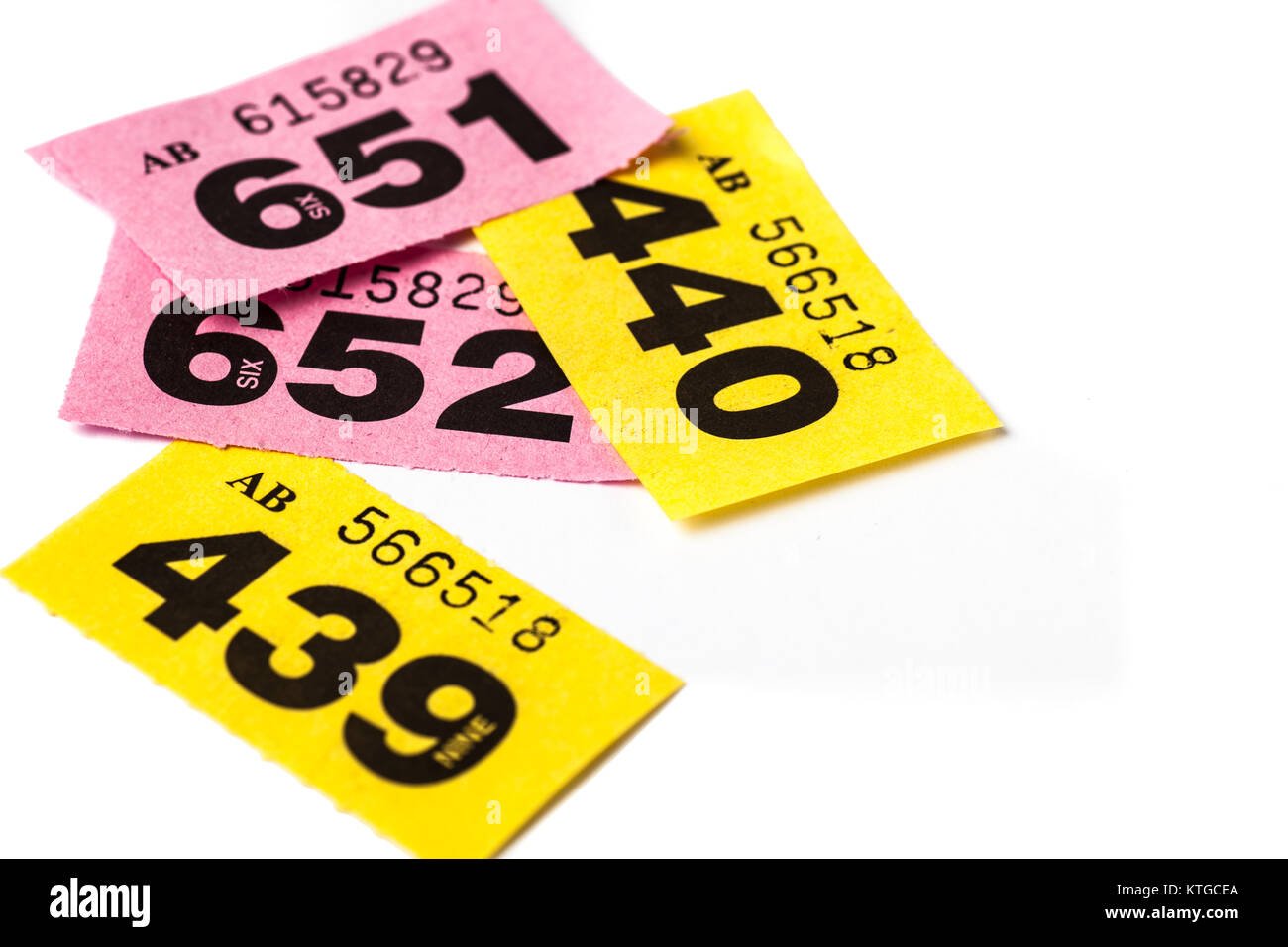 yellow and pink raffle tickets on white background