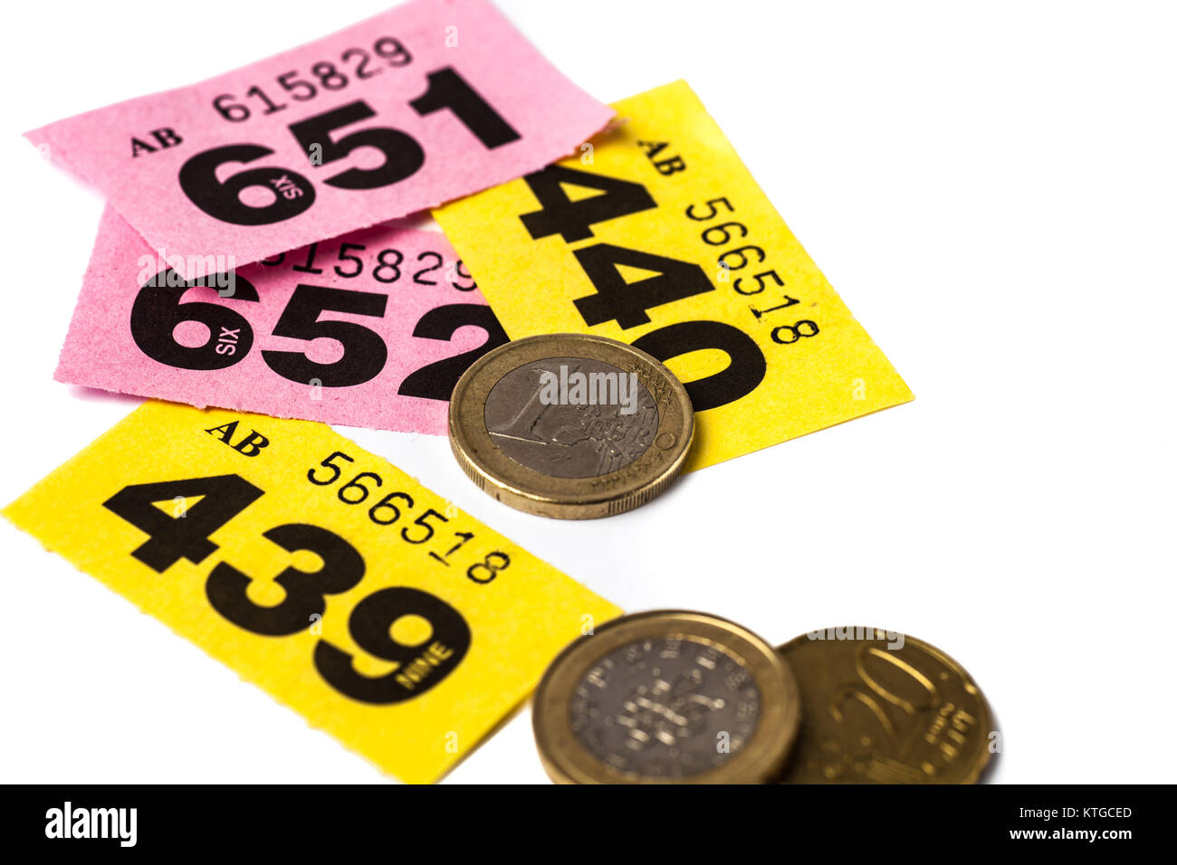 yellow and pink raffle tickets with euro coins stock image