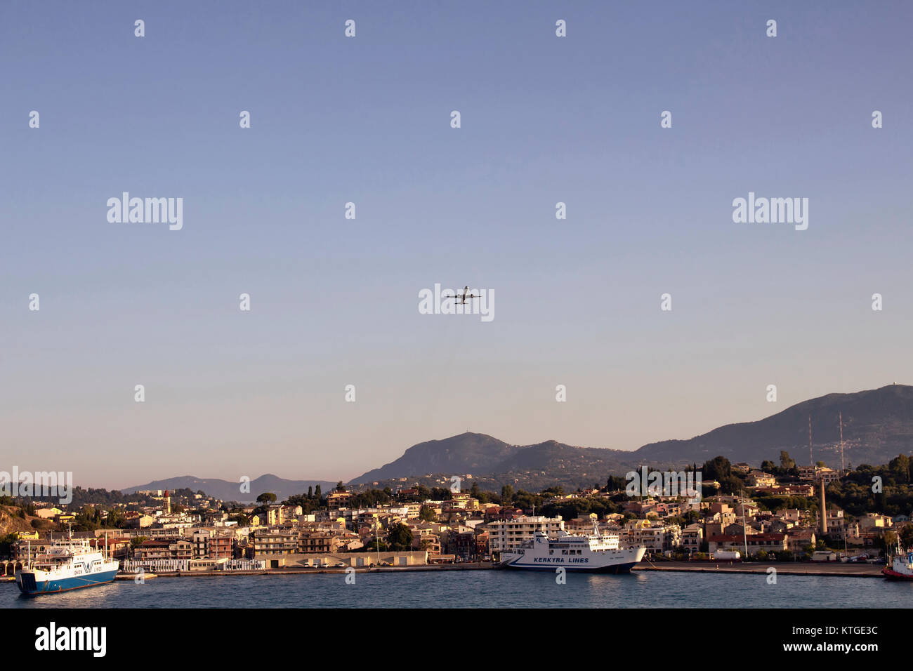 View of airplane over Corfu (Kerkyra) town, cruise ships. It's an island off Greece's northwest coast in the Ionian Stock Photo