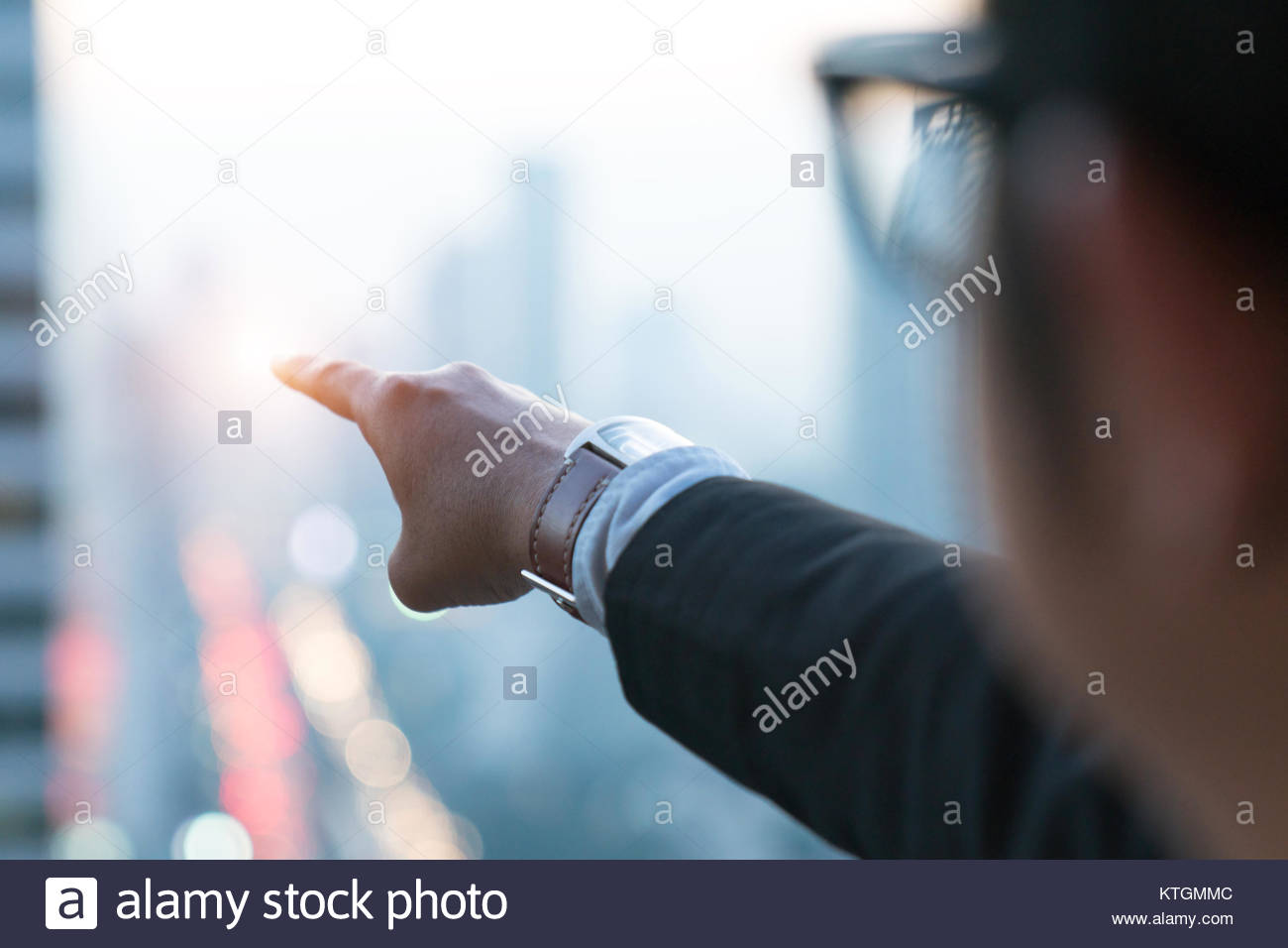Successful business people standing over cityand purposefully looking away. - Stock Image
