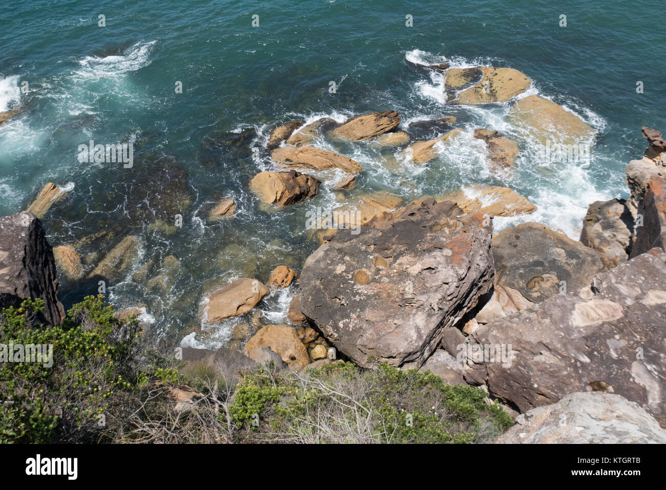 View from top of a hill onto the ocean - Stock Image