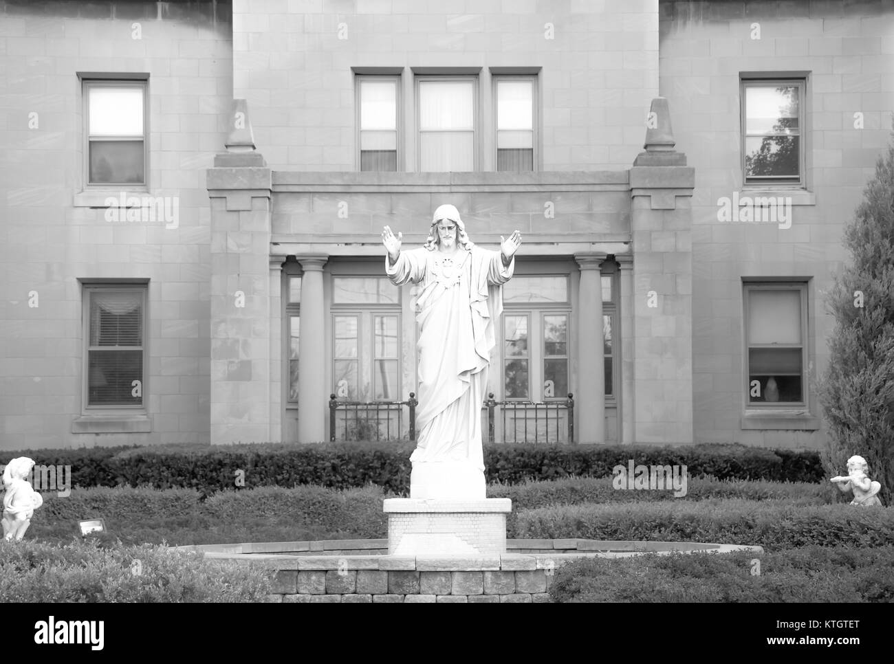 Black and white stock photo of marble statue of Jesus Christ in courtyard at the Church of St. Stanislaus Bishop - Stock Image