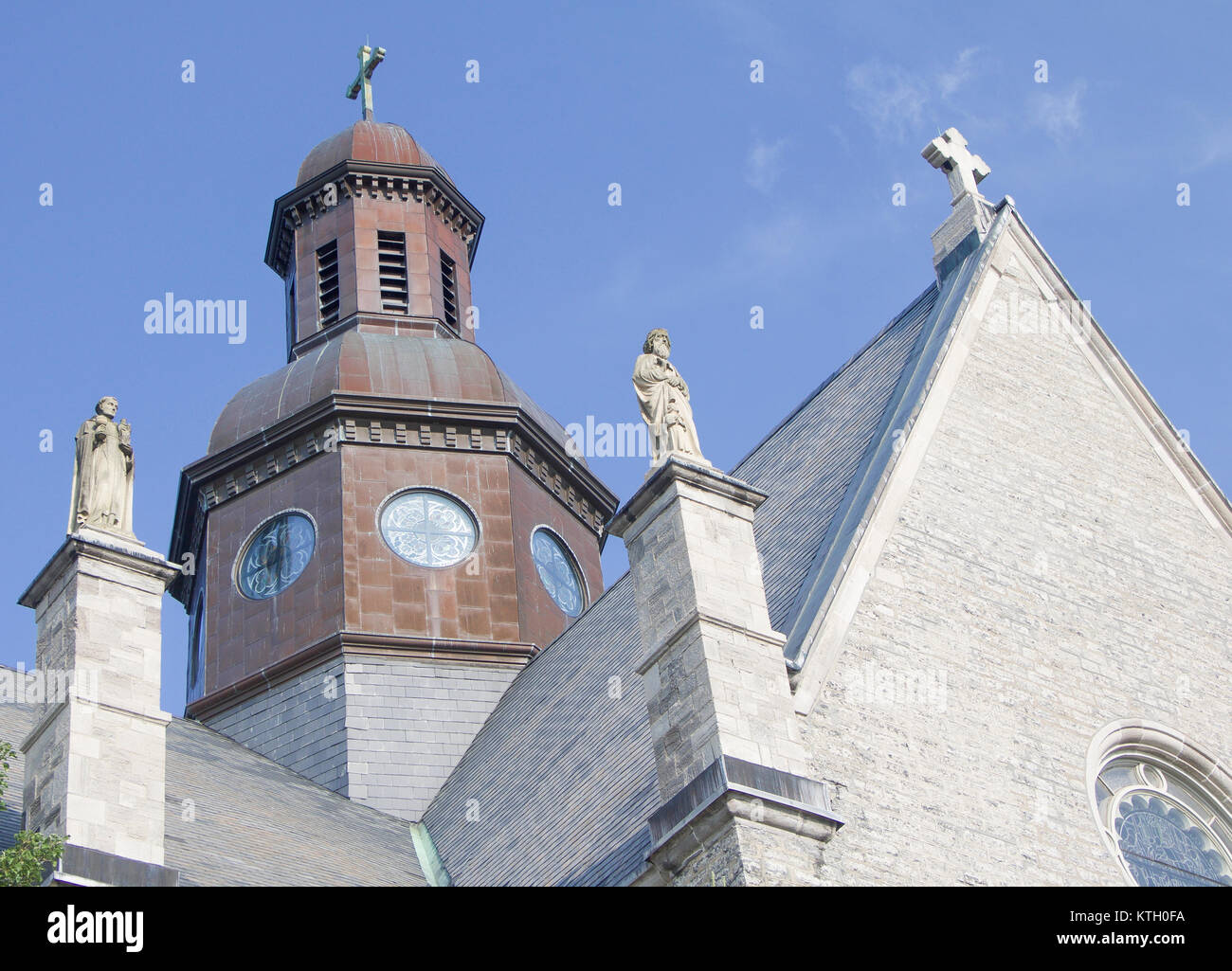 Exterior daytime steeple and statues atop Church of St. Stanislaus Bishop and Martyr named after Stanislaus of szczepanow - Stock Image