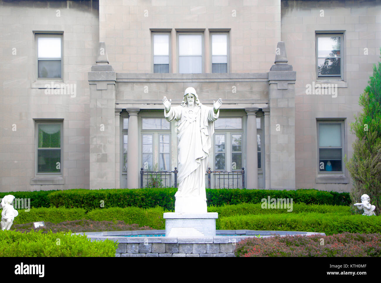 Exterior daytime marble statue of Jesus Christ in courtyard of Church of St. Stanislaus named for Stanislaus of - Stock Image