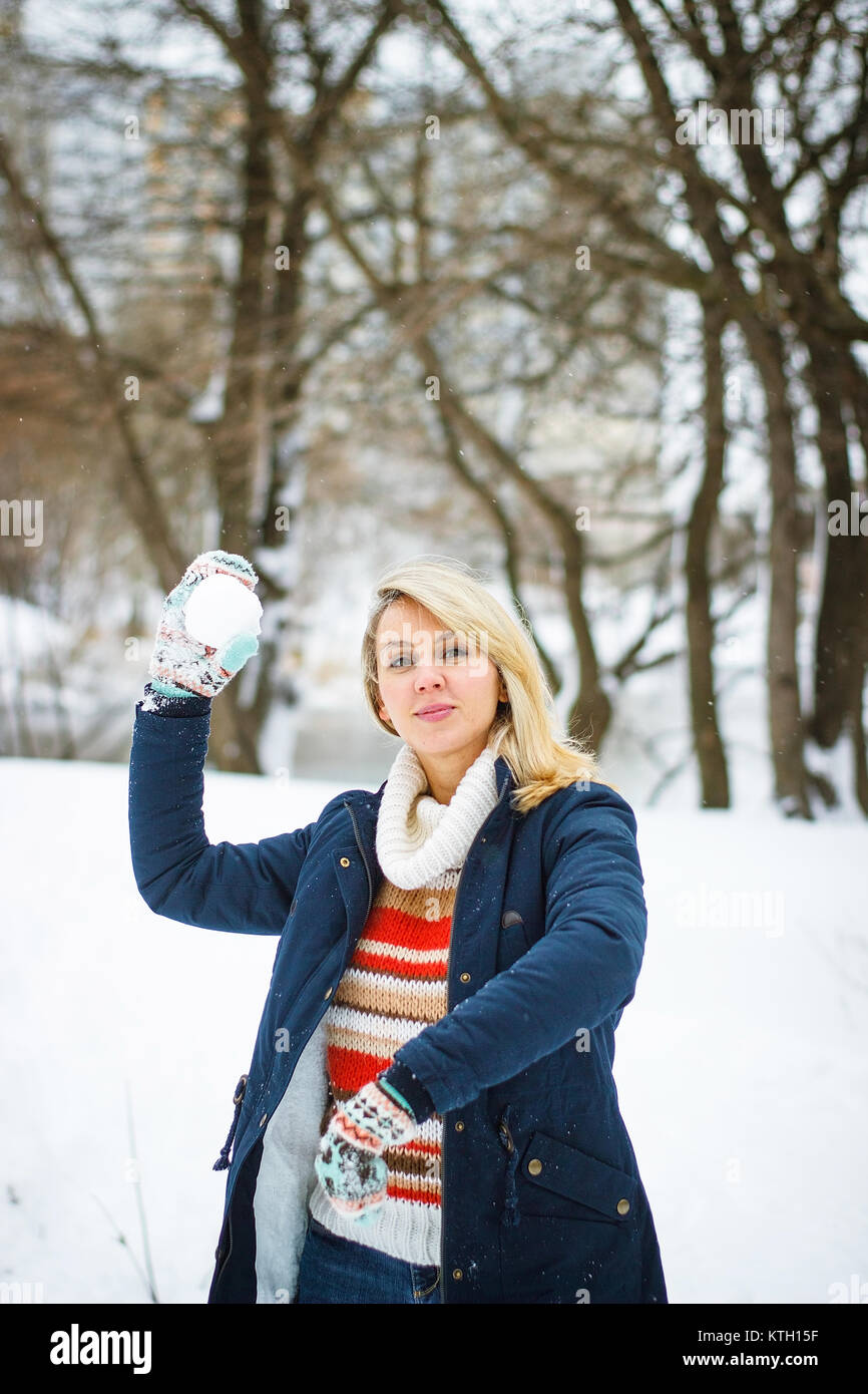 Winter girl play snowballs Stock Photo