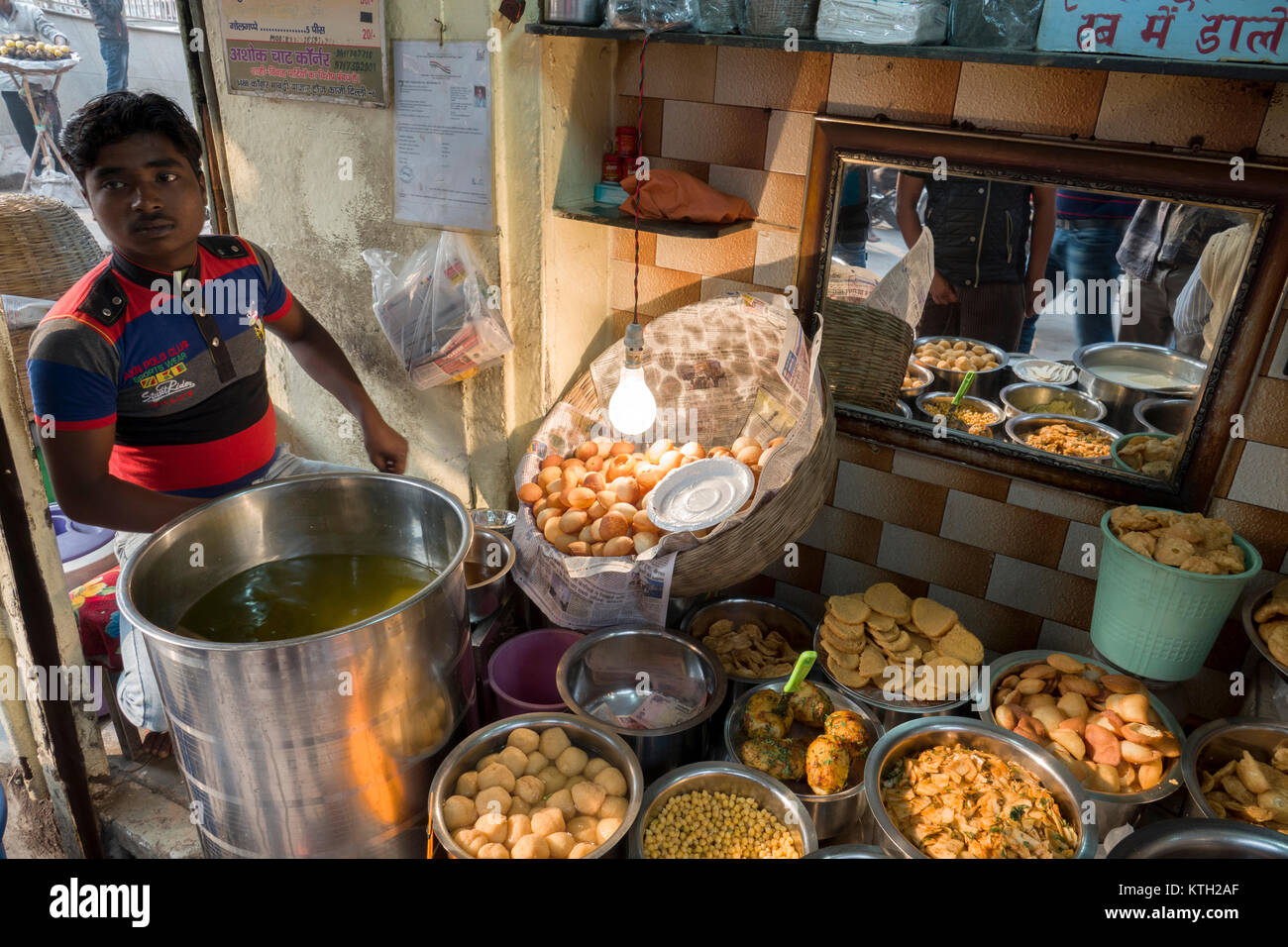 Man selling street food from stall in old Delhi, India - Stock Image
