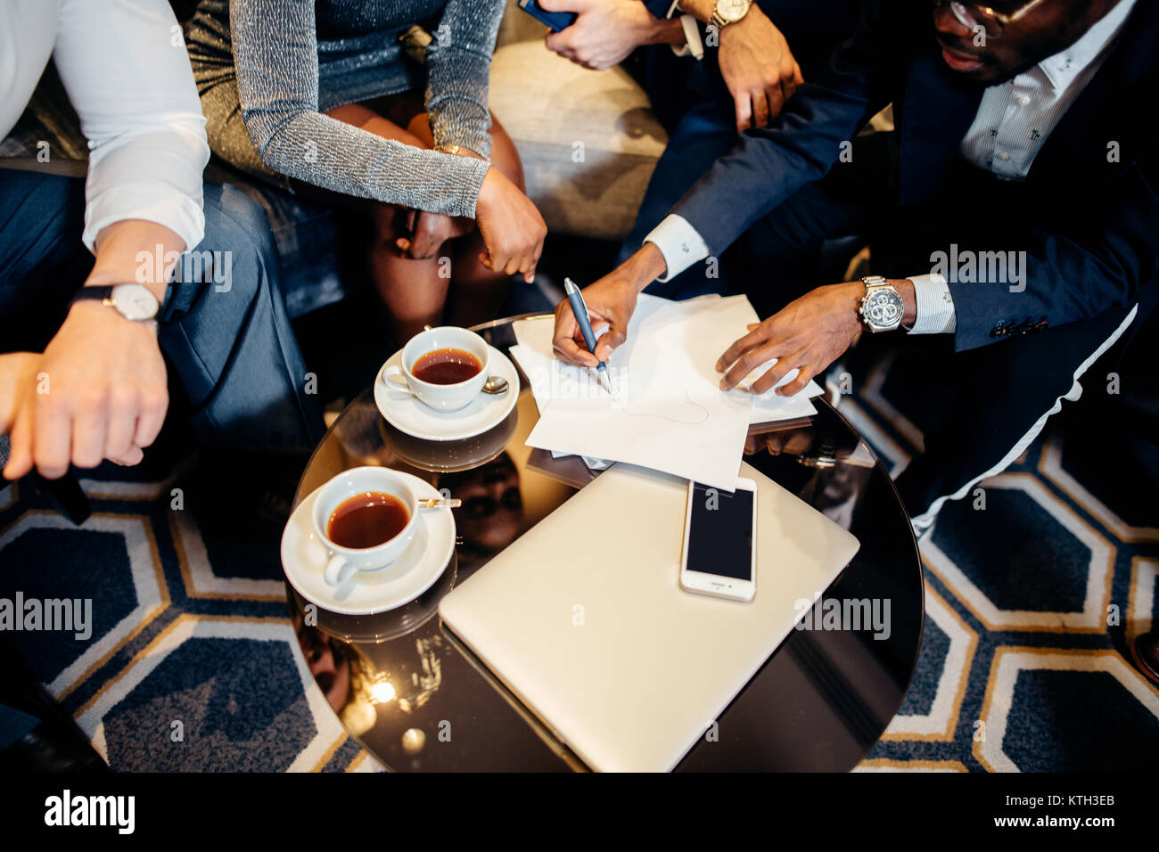 Business people meeting in office top view - Stock Image