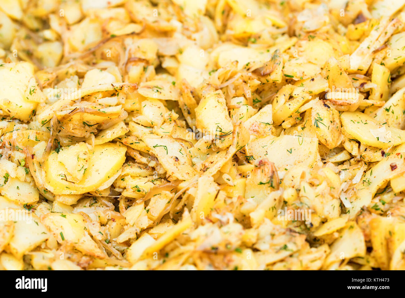 Pan full of potato wedges - Stock Image