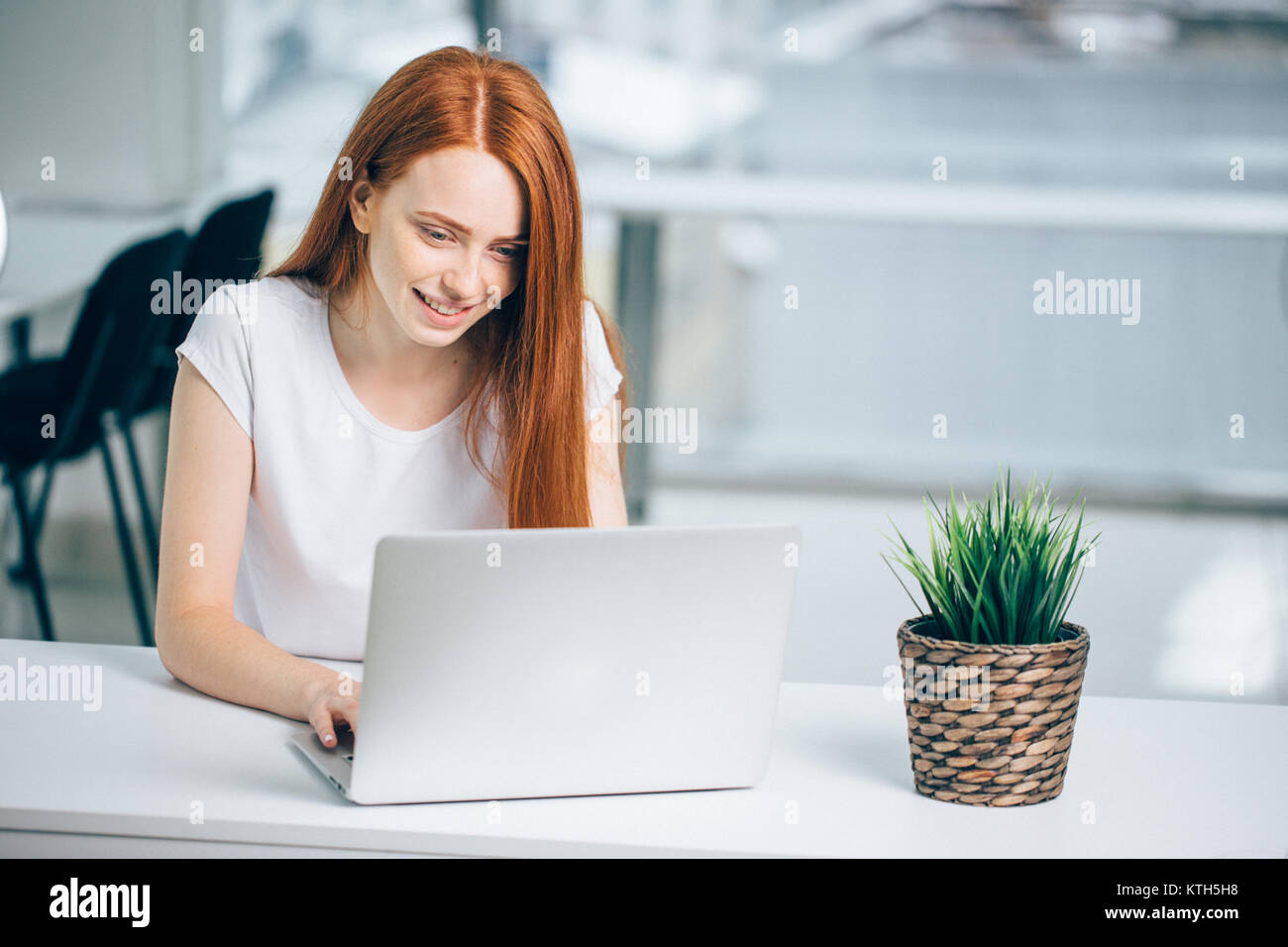 woman typing on laptop at workplace Woman working in home office hand keyboard Stock Photo