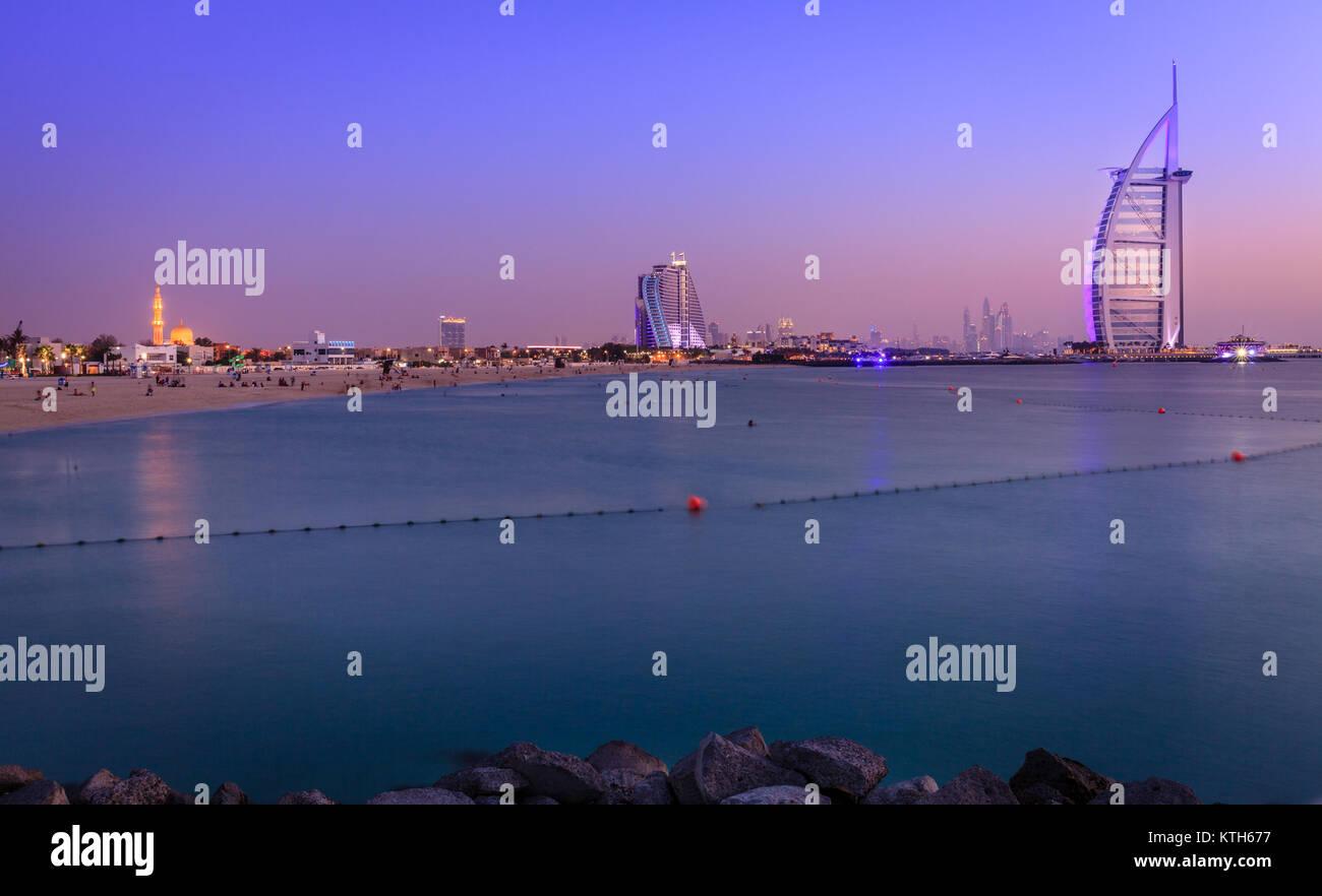 Dubai, UAE, June 7, 2016: view of world's famous Burj Al Arab hotel and Jumeirah Beach at dusk - Stock Image