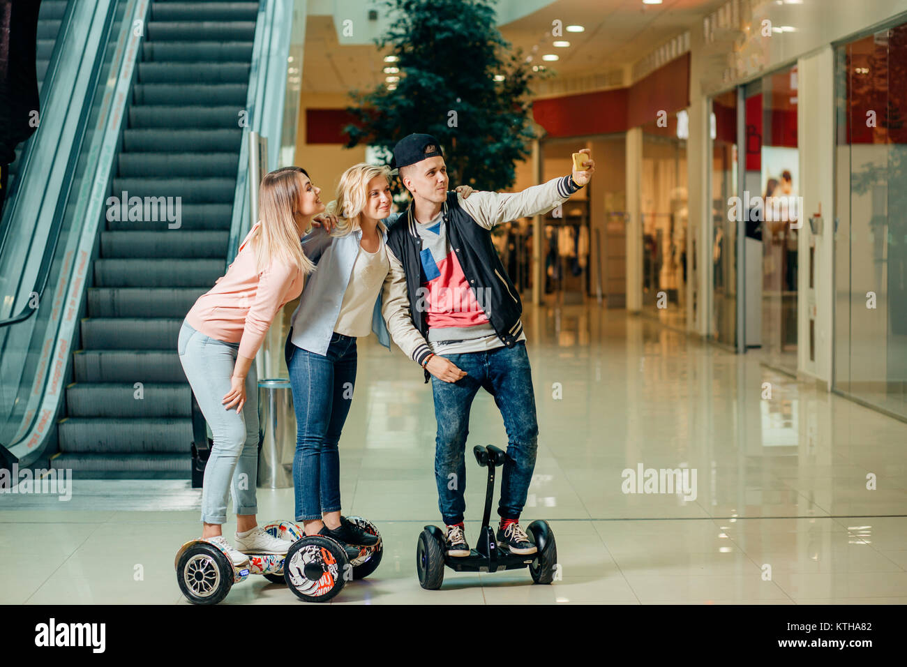 New modern technologies. three people on hoverboard doing selfie - Stock Image