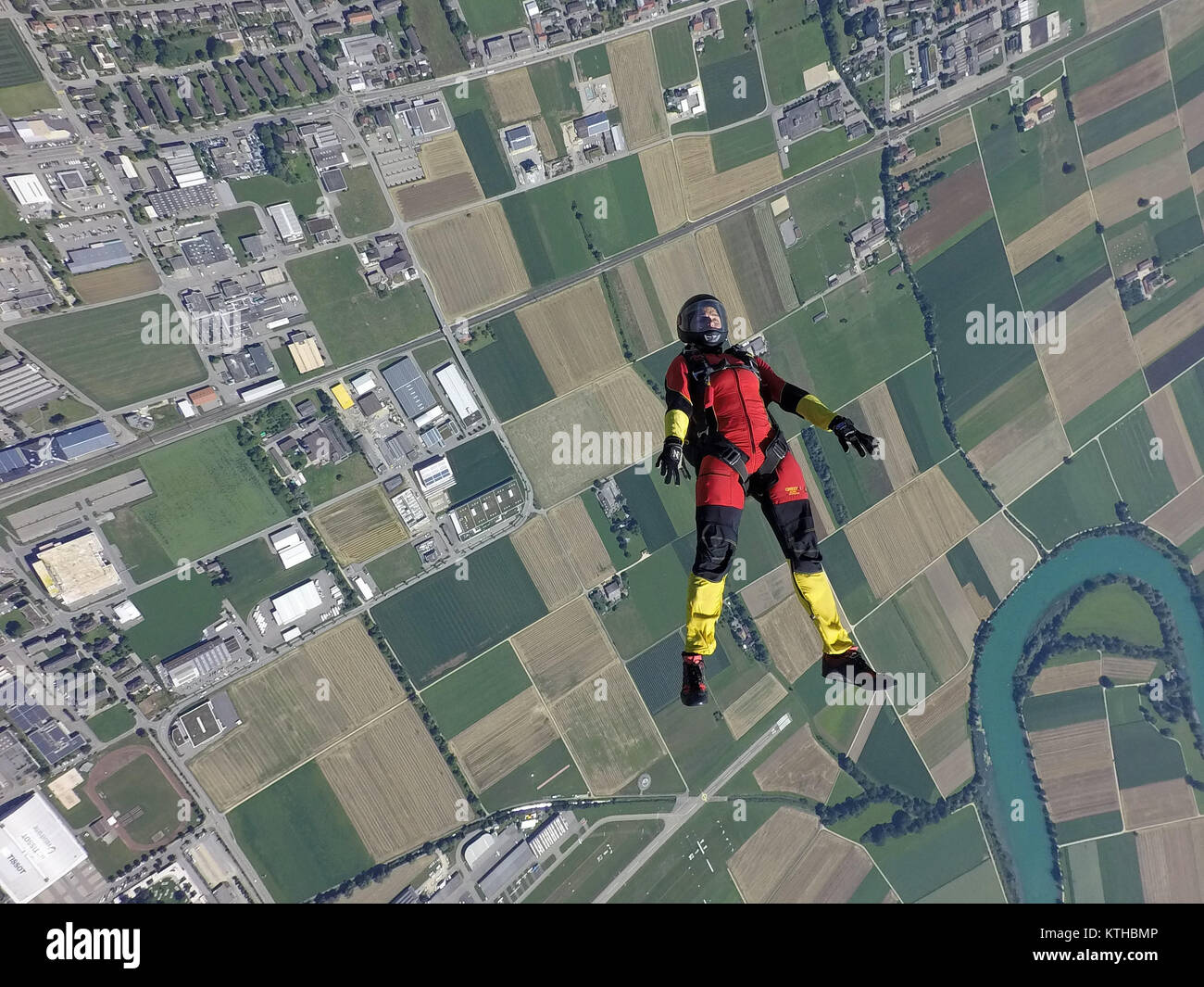 Look at this skydiving girl which is tracking on her back over a beautiful landscape with high speed over 125 mph - Stock Image