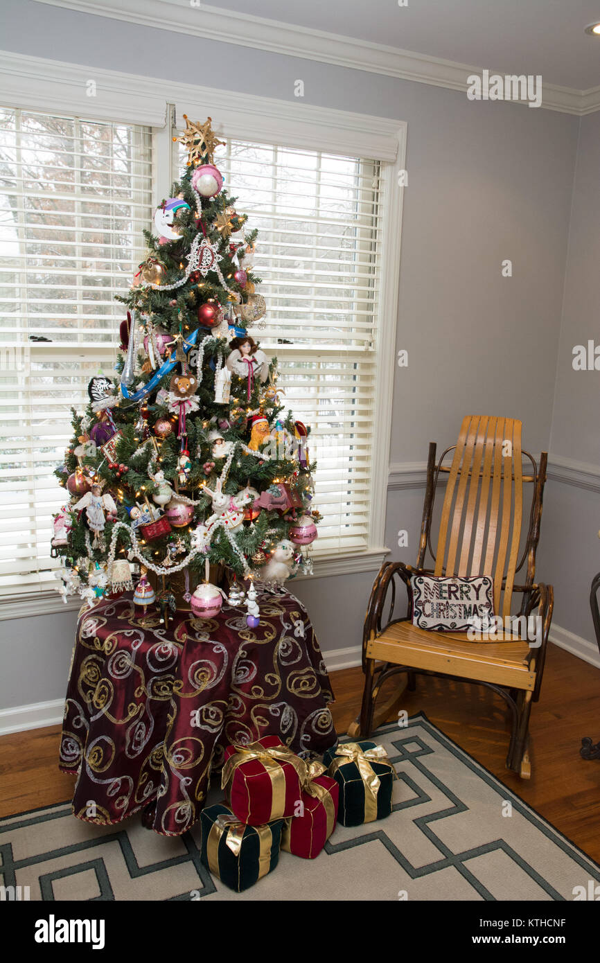 A small, beautifully decorated tabletop Christmas tree in