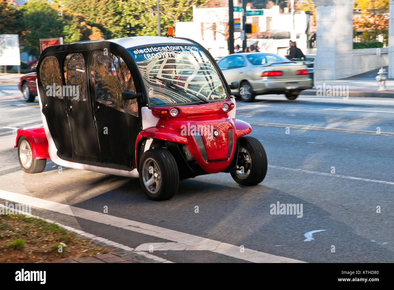An electric car on Atlanta street , capital of Georgia, USA - Stock Image