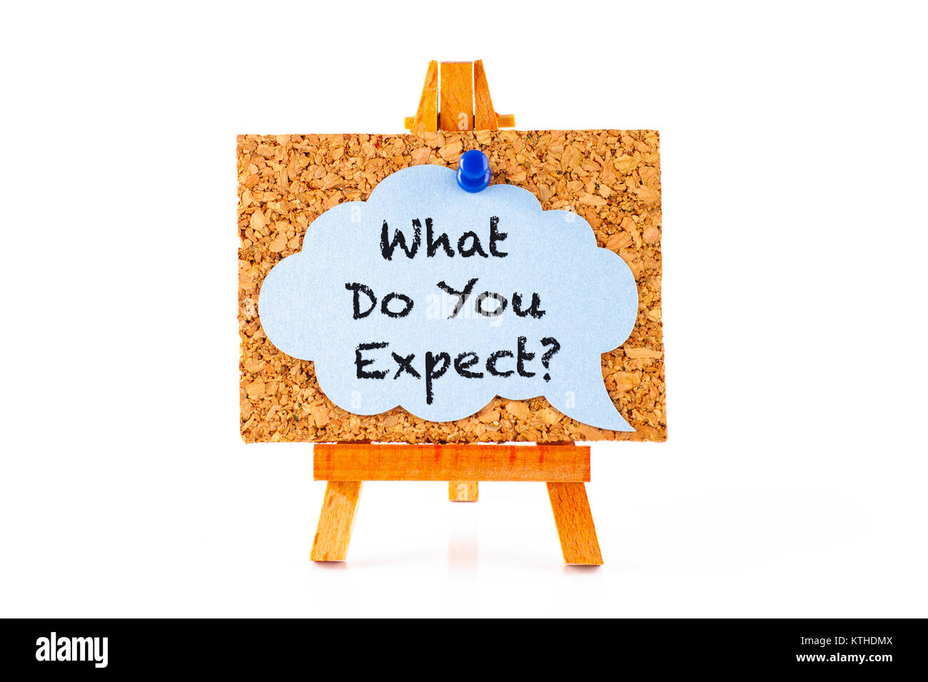 Phrase What Do You Expect? in blue speech bubble on corkboard with wooden easel. White background. - Stock Image