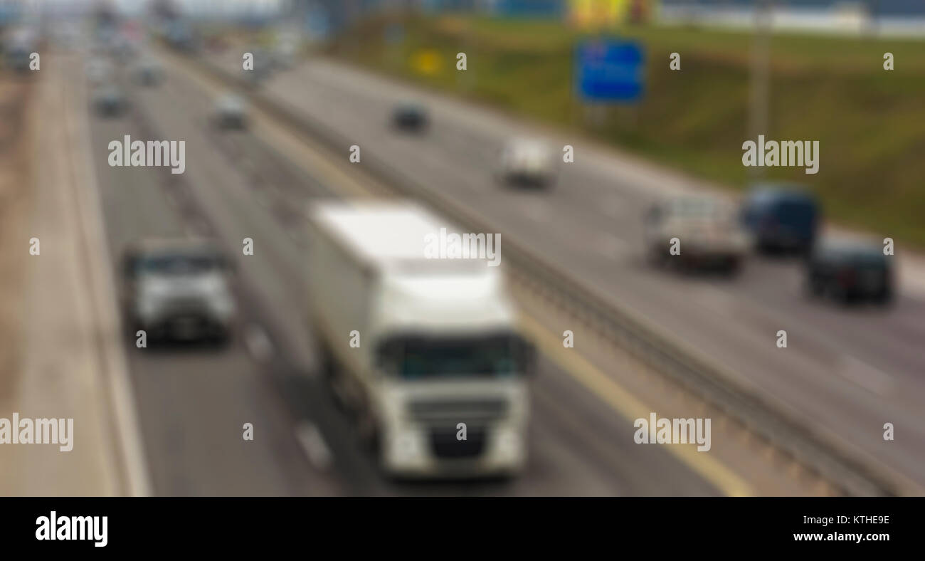 Automobile traffic on the highway the thematic blurred background - Stock Image