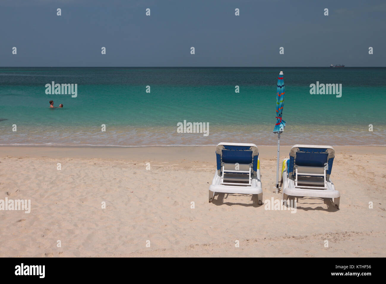 Chaise lounges on sandy beach. St. George's, Grenada - Stock Image
